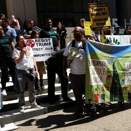 VIP speaks at an Earth Day rally with hundreds of others Environmental Justice activists at the US-EPA building in SF, 2017